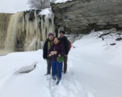 Our happy clients posing next to the frozen Jägala Waterfall